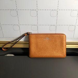 Metallic Orange Coach Wristlet